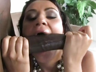 Cock sucking brunette slut receives huge black cock up her hairy minge