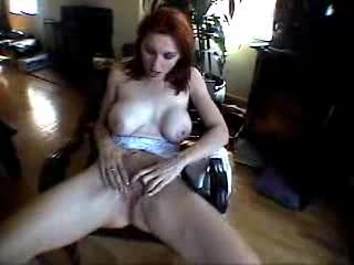 Redhead with great bumpers masturbates