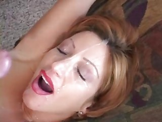 Older woman gets a face load of cum