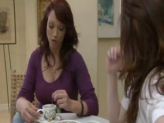 Two concupiscent brunette MILF's have tea party and lick each others pussy