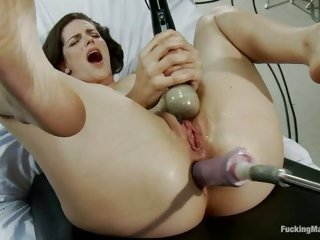 Slutty nympho couldn't help moaning as she gets banged by a fucking machine
