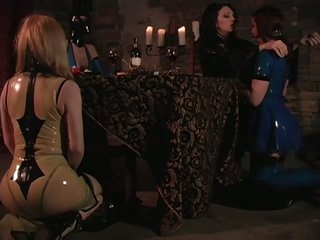 Mistress Jean Enjoys Latex Clad Slaves