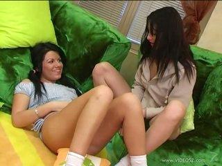 Lovely Brunette Lesbians Sharing a Dildo