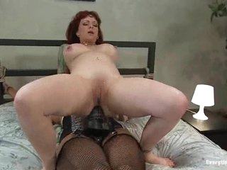 Hot bitch that loves anal fuck herself with a large dark strap-on