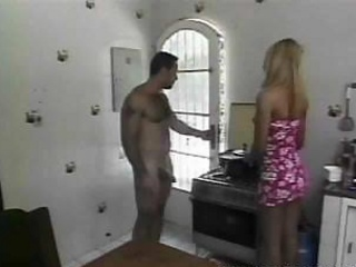 Handsome stud bonks a Tgirl on a kitchen table