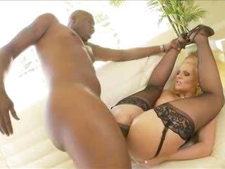 Hot blonde rides big dark cock