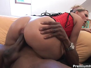 Blonde Patricia in black stockings and red corset has crazy interracial sex with dark skinned guy. He drills her white pussy and then this babe takes his dick in her mouth to make him explode.