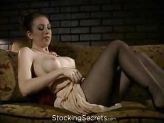 Red Heaven plays through her pantyhose