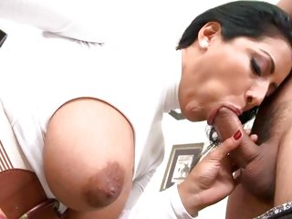 Big titted Kiara Mia throat fucks a stiff prick