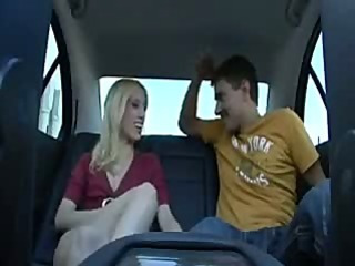 Blonde teen is in the backseat sucking and fucking his cock