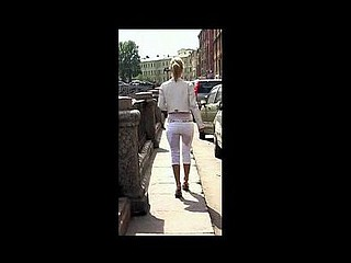 Discomfited cutey in pee-wet white jeans