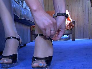 Nasty beauty readily showcasing her nyloned feet in spike heel sandals