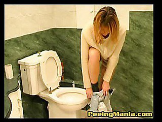 Itchy blond bunny has a slash in toilet