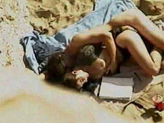 Sexy slut fucks the first guy that walks by on the sandy beach in this amateur fucking video. She rocks his cock as he rams her from behind in her sexy lingerie.