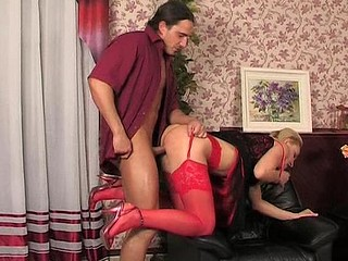 Dressed up honey in sexy red lacy nylons getting down with her hung date