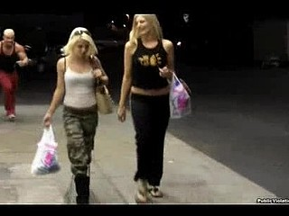 Two Cute Angels shopping at the ninety nine cent store are being stocked by a pair of creepsters. One Time they go out side one of the dudes runs up and pulls the blond's pants down. Is there grass on the field?