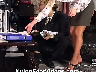 Voluptuous secretary in shiny tights having nylon amusement at lunch-hour