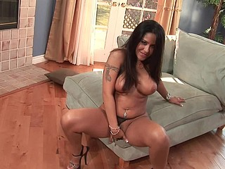Jenaveve Jolie is one of the hottest Latinas in porn.  This Babe has large boobs and is always hungry for sex.  This Babe's in a red and black camisole with patching pants.  This Babe gyrates in advance of the camera and gets us all rock hard and gets herself hard with just her fingers.