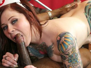 Sexy tattooed redhead nurse rides hard black wang in clip