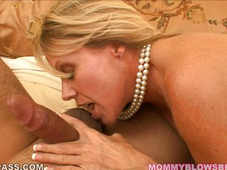 Blonde milf Nikki Charm still looks good for her age. She jerks, sucks, licks, and deepthroats this thick, hard cock. Nice touch with the pearl necklace, too. (literal pearl necklace)