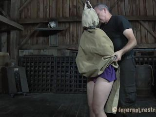 With a bag on her head Sasha is about to experience something very interesting. The guy brought her in this barn and started playing with her and taking those clothes off. He rips her panties and then tries that big round ass with his hard cock. Wanna know what else he will do with her?