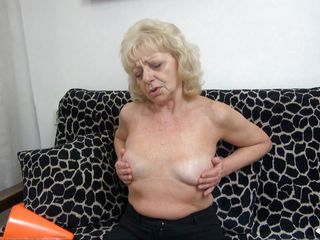 Granny needs to climax. She's horny and alone but this bitch has her dildo! She takes a sit on the couch, makes herself comfortable and then spreads her thighs as wide as she can. Then, the old whore slowly inserts the dildo in her saggy cunt and moans with delight. Enjoy yourself granny and be careful at those hips!