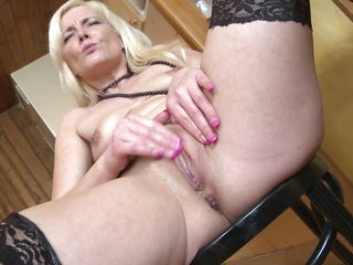 Horny blonde mature wearing only stockings and high heels goes wild in front of the camera. She spreads her thighs and rubs that shaved vagina before she grabs her special dildo with a whip attached on it and licks it. She deserves a real dick, maybe when she finishes with that sextoy this slut will get one!