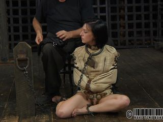 Sexy brunette Elise is all tied up and chained and sits obedient on the floor near to her executor who puts a mask on her face. He explains this bdsm technique and what she is supposed to do. The bitch enjoys being the center of attention and waits for her bondage treatment. Wanna see what happens to her?