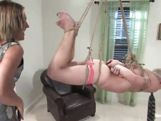 After slave boy Billy finishes vacuuming, blonde, milf mistress Gwen Diamond hangs him from the ceiling for humiliation. She clamps his nipples, cuts off his panties and makes him eat them. As a reward for cleaning, Billy gets weights hung from his cock and balls until he can't take anymore pain.