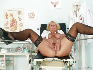 This granny nurse is lying on medical bed and she want to play with her sexy pussy at work. She have big and round boobs and a shaved and large vagina. The blonde nurse have a long dildo and she introduce it very deep in the vagina because she want to have a great orgasm.
