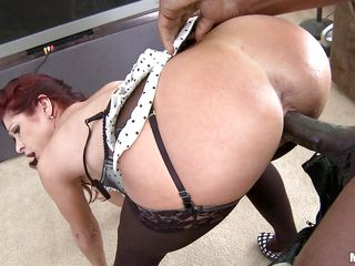 White redhead milf gets her big ass licked and fucked hard by a black dude with a huge dick. First off she sucks him really good to make him ready for action. She really loves it to take it from behind. This black dude seems to really love some white milf ass cause he cant really stop pounding it.