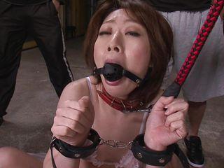 Rio Kagawa is a sex slave milf. She is in shackles and a leash and is being lead around like the whore milf she is. She gets a cock shoved deep in her throat and she pleases her masters by sucking on the balls.