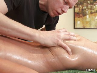 This blonde with big tits and a sexy body is getting a massage. Look how horny she gets when he pours oil on those big perfect tits and than fingers her tight pussy. Is she going to get some hard cock down there or some spunk on her dirty mouth?