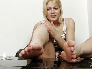 She's blonde and very pretty. This sexy milf named Ruth plays with her sexy feet and rubs that big black dildo with them. Look at her, we think that she's getting horny and it's just a matter of time until Ruts is going to insert that dildo in her, the question is where? Can you take a guess?