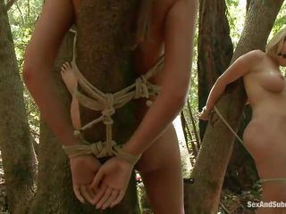 Well what do we have here? Two naughty cunts ball gagged and tied on trees. This guy pays them a visit and fucks the brown haired one while the blonde watches, scared of what he will do to her after finishing with her girlfriend. These cuties are sexy with small tits and pretty face so surely the guy will fuck them hard