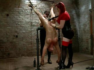 Mz Berlin always gives a punishment in a manner that makes our cocks hard. She has in her front a whore that awaits to be punished and that's all she needs to get back to work. The pretty slut is hanging upside down and those big round boobs are demanding some whipping along with the rest of her body so she whips her and then licks the cunt between those hot thighs until it's time for some sex toys.