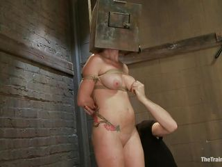 Redhead Audrey has a box on her head until the executor approaches her and gives this bitch some freedom. He played with her big soft boobs and now wants to see her play with a big hard dick. Audrey is a fucking cheap whore and she immediately begins masturbating before sucking the sex slave's dick with pleasure