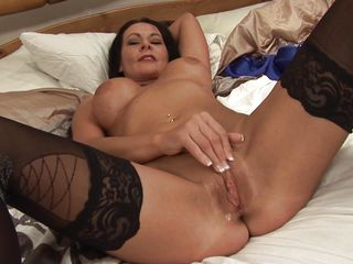 This lady is at the end of her thirties and yest she has this amazing hot body with busty big boobs that will give any guy a boner. See how this hot woman is teasing only on her stockings and pleasing herself with masturbation. She fingers her own clitoris and pussy before taking huge dildo to fuck herself.