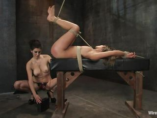 That anal plug conducts electricity straight to her rectum and the dildo the sexy brunette uses gives her even more pleasure as she drills her cunt with it. Look at her all tied up on that table with her nice ass red from a lot of slapping. She screams and moans in that vault but her screaming only excites her mistress.