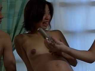 Sweet-looking Oriental chick widens legs and gets fingered
