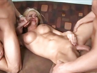 Handsome pale blonde with huge milk sacks gets slammed by two dicks