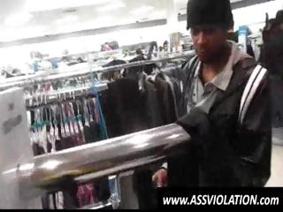 Sexually excited twink gets on his knees and sucks black cock in a store