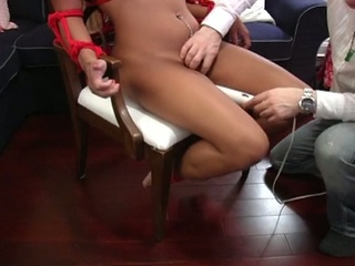 Asian babe bound and fucked by a vibrator
