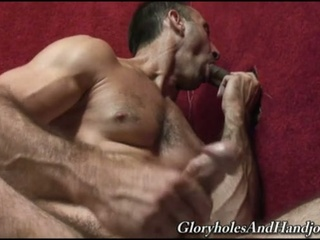 Homosexual hunk jerks whilst sucking cock