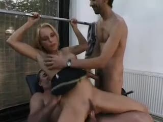 Two guys fuck a slut in the gym